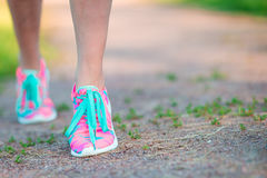 Healthy active lifestyle woman athlete tying running shoes. Sporty girl getting ready for jogging workout. Closeup of Royalty Free Stock Images