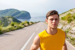 Healthy active man runner running on the road Royalty Free Stock Photography