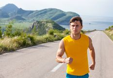 Healthy active man runner running on the road Stock Photo