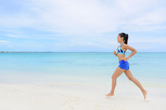 Healthy and active running woman jogging on beach Royalty Free Stock Photography
