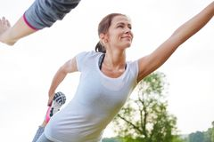 Healthy woman stretching her legs royalty free stock photography
