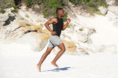 Healthy active young african man running on the beach Royalty Free Stock Photography