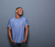 Healthy african american man smiling. Portrait of a healthy african american man smiling on gray background Stock Photo