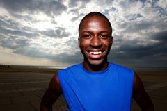 Healthy african man standing outdoors and smiling. Close up portrait of healthy african man standing outdoors and smiling Royalty Free Stock Photography