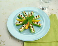 Healthy Afternoon Snack. Of celery sticks with cream cheese and sultanas Stock Images