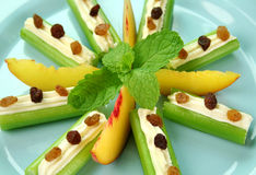 Healthy Afternoon Snack. Of celery sticks with cream cheese and sultanas Stock Photos