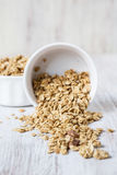 Healthy Almond Breakfast Cereal Granola Spilling From White Bowl Stock Photography