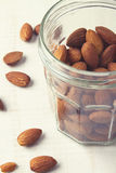 Healthy almonds in around a mason jar Royalty Free Stock Photo