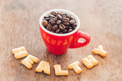 Healthy alphabet biscuit with red coffee cup Stock Images