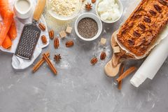 Healthy alternative vegan carrot cake, vegetarian pastries ingredients: chia, coconut butter, almond milk, nuts. Carrot bread, li. Ght background royalty free stock photo