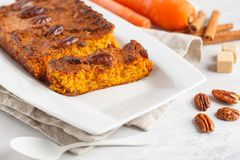 Healthy alternative vegan carrot cake, vegetarian pastries ingredients: chia, coconut butter, almond milk, nuts. Carrot bread, li. Ght background stock photo