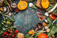 Healthy And Organic Harvest Vegetables And Ingredients: Pumpkin, Greens, Tomatoes,kale,leek,chard,celery On Rustic Kitchen Table B Stock Photos