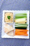 Healthy appetiser platter of hummus and raw vegetables Royalty Free Stock Image