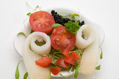 Healthy appetizer. With smoked fish and tomato stock photos