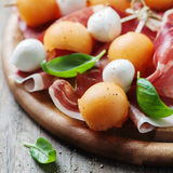 Healthy appetizer with melon, ham and mozzarella Royalty Free Stock Photography