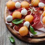 Healthy appetizer with melon, ham and mozzarella Stock Image