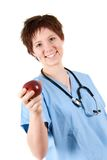 Healthy Apple. Cute doctor holding an apple on white royalty free stock images