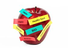 Healthy apple. Strips of labels on apple - diet concept Royalty Free Stock Photos