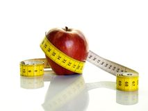 Healthy apple. Red apple with measuring tape Stock Photo