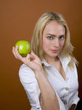 Healthy apple. Being showcased by model Royalty Free Stock Image