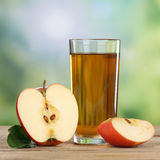 Healthy apple juice drink and red apples in autumn Royalty Free Stock Photos