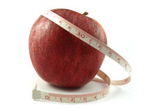 Healthy apple and measuring tape Stock Photos