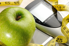 Healthy apple, measuring tape and scale. Apple,measuring tape and scale  for a healthy life Stock Photos