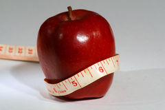 Healthy apple nutrition. Red apple with a tape measure Stock Images