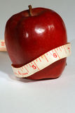 Healthy apple nutrition - Vertical. Red apple with a tape measure Royalty Free Stock Photos