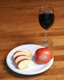 Healthy apple snack and glass of wine Stock Photography