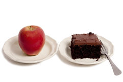 Healthy Apple and Unhealthy Cake Stock Images