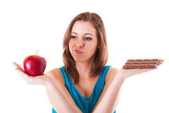 Healthy apple or unhealthy chocolate? Royalty Free Stock Images