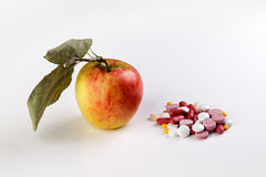 Healthy Apple vs Pills Stock Photos