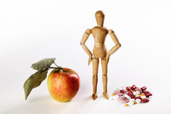 Healthy Apple vs Pills Stock Photo