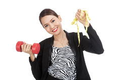Healthy Asian business woman with dumbbells and measuring tape Royalty Free Stock Photography