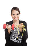 Healthy Asian business woman with dumbbells and measuring tape Stock Photo
