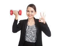 Healthy Asian business woman show OK with dumbbells Stock Image