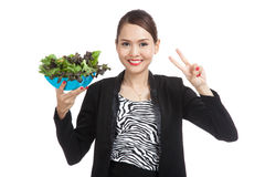 Healthy Asian business woman show victory sign with salad Stock Photos