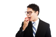 Healthy Asian businessman eat red apple Stock Image