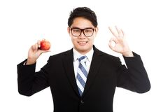 Healthy Asian businessman OK with red apple Royalty Free Stock Image