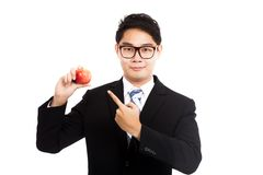 Healthy Asian businessman point to red apple Royalty Free Stock Images
