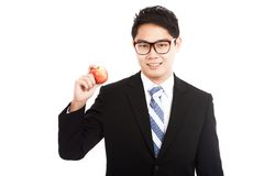 Healthy Asian businessman with red apple Royalty Free Stock Photo