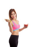 Healthy Asian girl diet with tomato juice and measuring tape on Stock Images