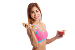 Healthy Asian girl diet with tomato juice and measuring tape on Stock Photo