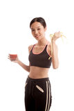 Healthy Asian girl diet with tomato juice and measuring tape on Stock Photography