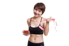 Healthy Asian girl diet with tomato juice and measuring tape on Royalty Free Stock Image