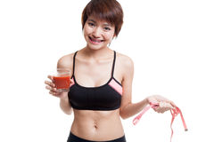 Healthy Asian girl diet with tomato juice and measuring tape on Royalty Free Stock Images