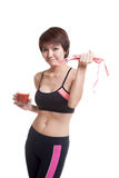 Healthy Asian girl diet with tomato juice and measuring tape on Royalty Free Stock Photos