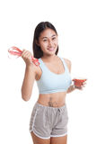 Healthy Asian girl diet with tomato juice and measuring tape on Royalty Free Stock Photography