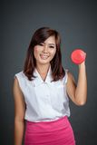 Healthy Asian girl hold a dumbbell and smile Stock Photography